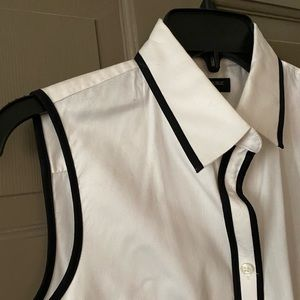 White sleeveless button up blouse